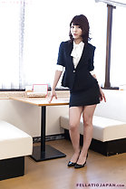 Office lady standing beside table wearing high heels