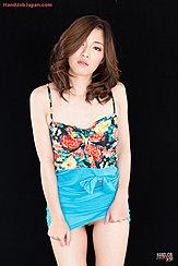 Natsuki Reina Raising Hem Of Dress Exposing Her Pussy