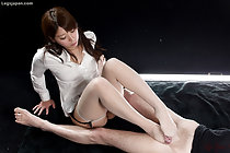 Giving footjob wearing stockings long hair over her white shirt