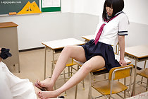 With bare legs and feet kogal giving footjob in classroom