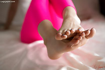 In pink leggings bare feet together