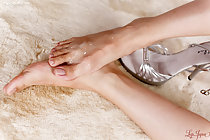 Yuuki Ryo raising bare foot covered in cum high heeled shoe