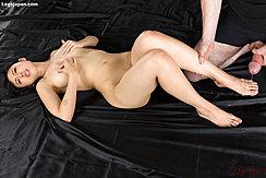 Man Holding Her Leg Cumming Across Her Foot Fondling Her Tits