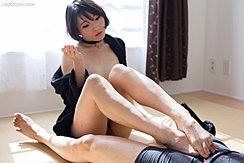 Knees Raised Legs Stretched Out Rubbing Her Bare Feet Over Spent Cock