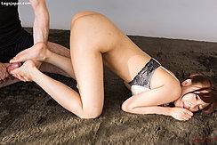 Rubbing His Cock Between Her Feet Bare Ass Raised Wearing Bra