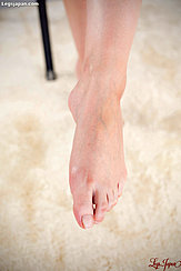 Holding Out A Bare Foot
