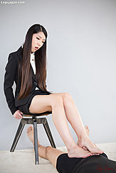 Rubbing Hard Cock Between Her Bare Feet Looking Down Intently Long Hair