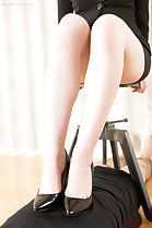Office lady sitting on stool wearing high heels