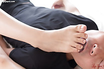 Man licking her toes