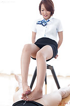Office lady sitting on stool wearing short skirt cum on her bare feet