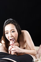 Licking head of hard cock
