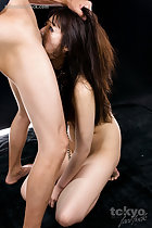 Hand in her long hair pulling her head back Shiina Mizuho deep throating cock on her knees