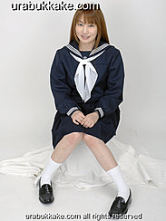 Kogal Seated In Uniform Hands On Her Lap Wearing Socks And Shoes