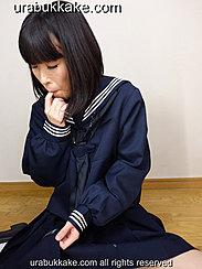 Seated On Wooden Floor In Seifuku Uniform Sucking Her Finger