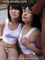 Megumi and Natsumi seated in front of masturbating man bukkake cum running down their faces